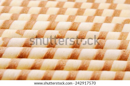 Background from striped sweet tubules - stock photo