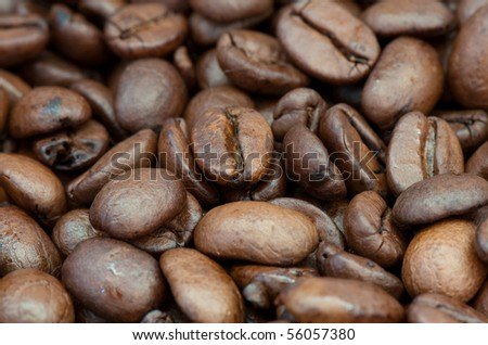 background from the spilled grains of Brazilian coffee