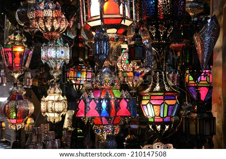 Background from traditional moroccan glass and metal lamps in shop in the medina of Marrakech, Morocco