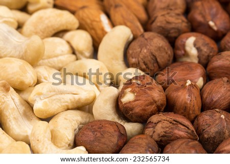 Background from various kinds of nuts (almond, hazelnut, cashew) - stock photo