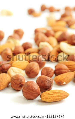 Background from various kinds of nuts (almond, hazelnut, cashew, Brazil nut) on white - stock photo