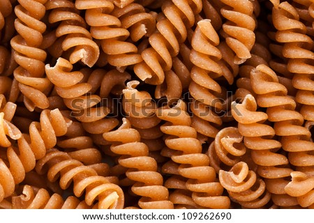 background from whole wheat corkscrew pasta