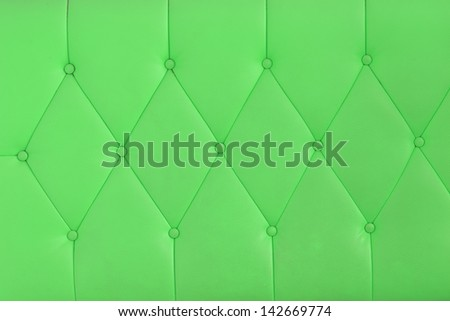 Background green sofa. - stock photo