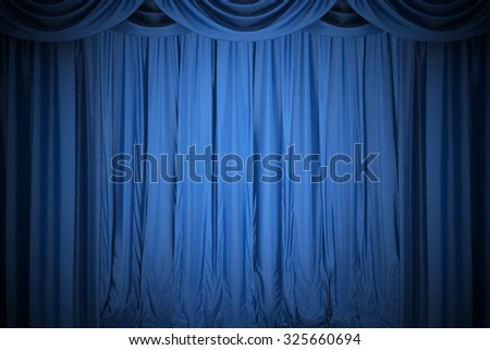 Background image of blue silk stage curtain on theater - stock photo
