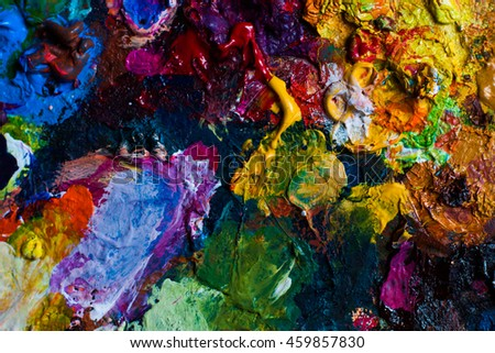 Background image of bright oil-paint palette closeup. Can be used for design, websites, interior, background, backdrop, texture creation, the use of graphic editors and illustration.