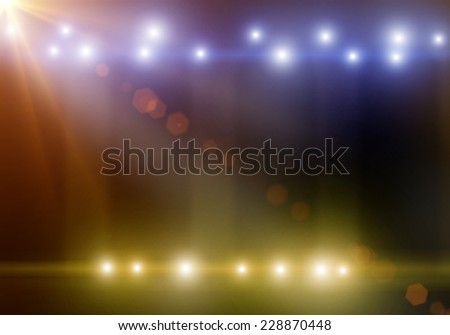 Background image of colorful stage lights and beams - stock photo