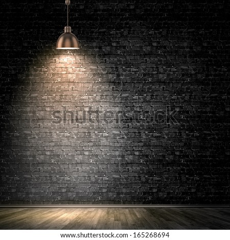 Background image of dark wall with lamp above - stock photo