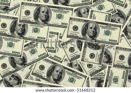 Background image of many one hundred dollar bills.