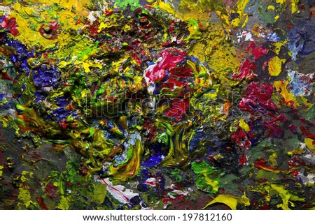 Background image of messy colorful acrylic palette closeup - stock photo