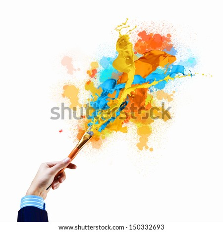 Background image with human hand holding paint brush
