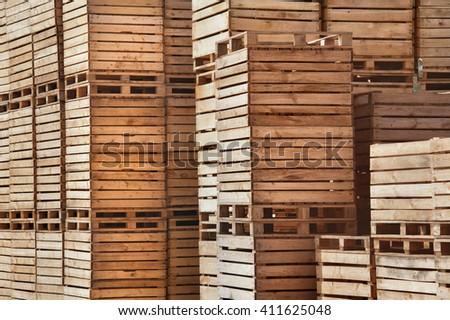 background lot of wooden boxes on pallets - stock photo