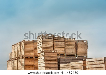 background lot of wooden boxes on pallets. on top of the visible sky - stock photo