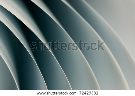 background macro image of black and white origami pattern made of curved sheets of paper. - stock photo