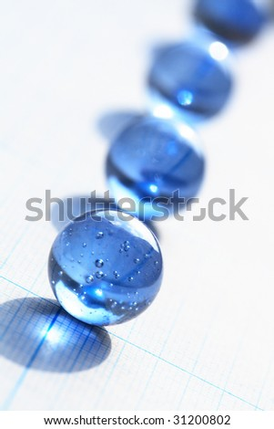 Background made from blue glass balls lying on squared paper