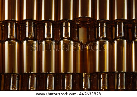 Background Made From Empty Brown glass bottles