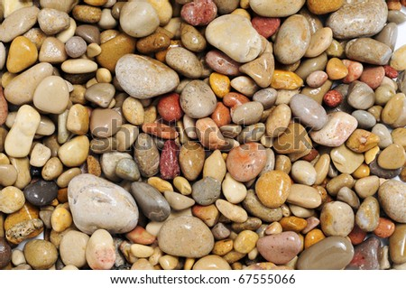 background made of a closeup of a pile of pebbles - stock photo