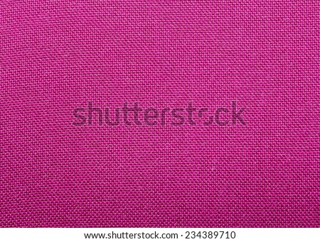 background made of a closeup of a violet fabric texture - stock photo