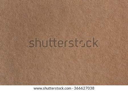 Background made of a closeup of brown paper. - stock photo