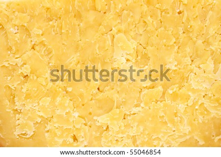 background made of a closeup of hard cheese - stock photo