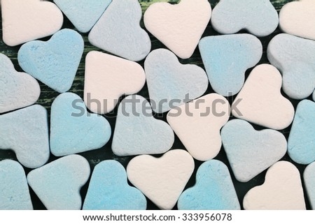 Background made of blue and white sugar hearts  - stock photo