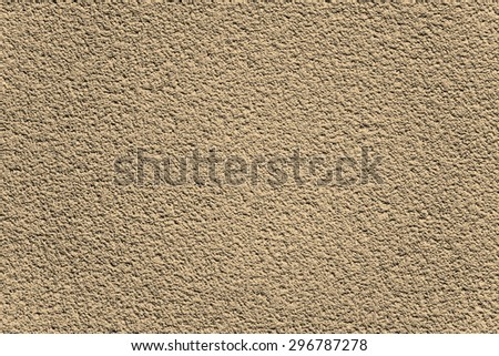 Background made of brown textured rugged plaster wall
