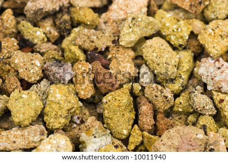 Background made of different colored vivid yellow rough gravel