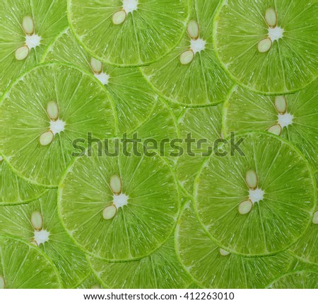 Background made of fresh ripe lime slices - stock photo