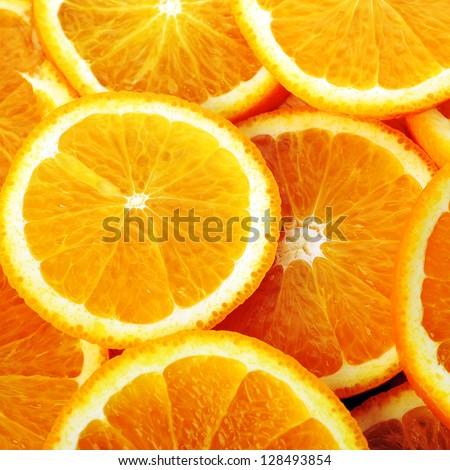 background made of sliced juicy oranges - stock photo