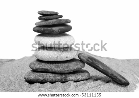 background made with zen stones in the sand black and white - stock photo