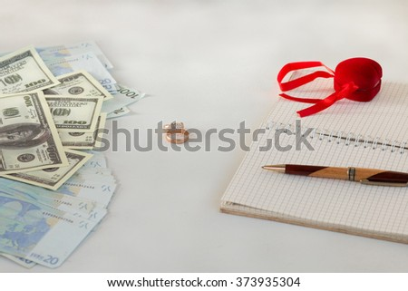 background, money , wedding rings , notebook notes pen, prepare for the wedding - stock photo