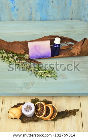 background natural soap rosemary oil salt and flavorings in rustic wooden background - stock photo
