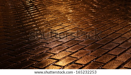 background, night wet pavement shining golden lights