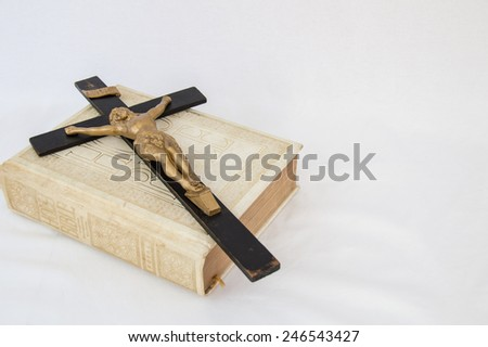 Background of a crucifix laying across a bible