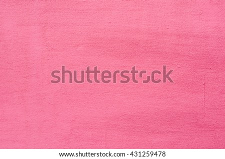 Background of a deep pink (rose-colored) painted wall  - stock photo