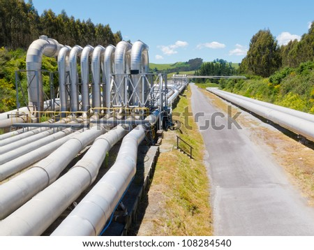 Background of a pipeline installation for distribution and supply of liquid and gaseous products, such as petroleum based resources, over long distances - stock photo