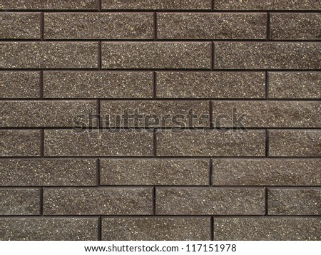 background of a wall decorated with rock tiles