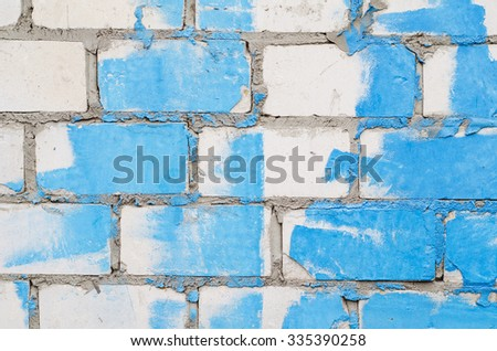 Background of a white brick wall with stains of blue paint  - stock photo