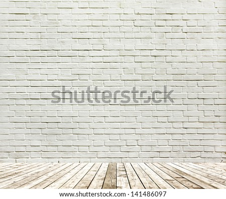 Background of aged grungy textured white brick and stone wall with light wooden floor with whiteboard inside old neglected and deserted empty interior, blank horizontal space of clean studio room