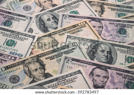 Background of American 5, 10, 20, 50, 100 dollar banknotes, close up view of cash money dollars bills in amount