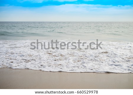 Background of beautiful beach sea sand waves blue sky clouds .selective focus.