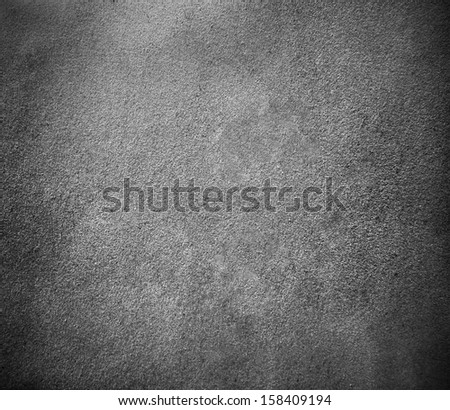 Background of black chamois leather and grunge natural suede texture closeup view - stock photo