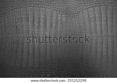 background of black crocodile skin texture - stock photo