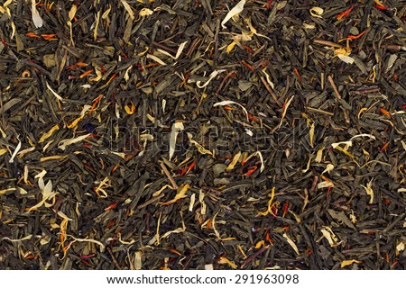 background of black tea leaves. View from above. - stock photo