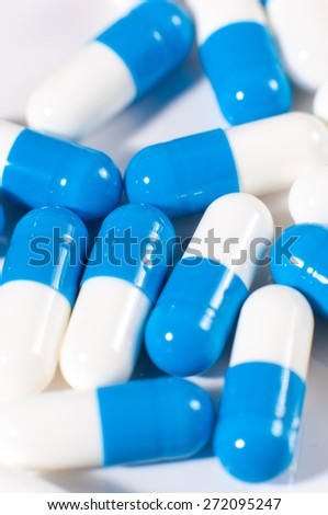 Background of blue and white capsule pills.