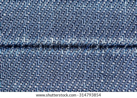 Background of blue denim jeans with seam. - stock photo