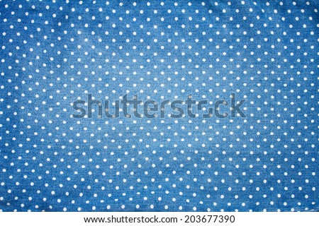 background of blue jeans with polka dot pattern - stock photo