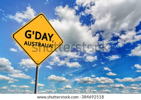 Background of blue sky with cumulus clouds and yellow sign with text G'day, Australia!