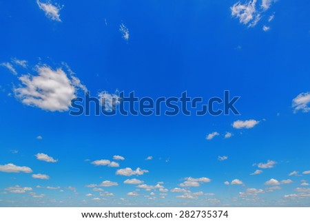Background of blue sky with rare clouds - stock photo