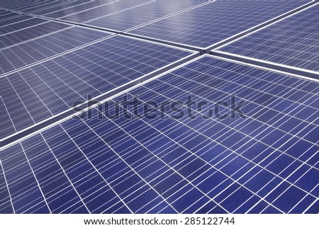 background of Blue solar panels to produce electricity. - stock photo