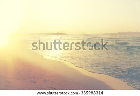 background of blurred beach and sea waves, vintage filter.  - stock photo
